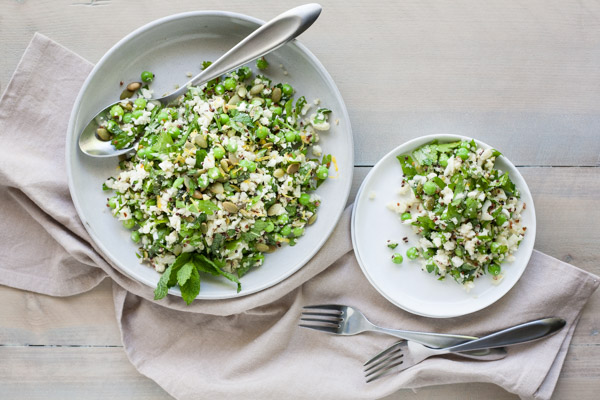 Quinoa Cauliflower Tabbouleh Salad | BourbonandHoney.com -- This Cauliflower Tabbouleh Salad is a fresh spring dish of cauliflower and quinoa paired with herbs, fresh peas, lemon and toasted pepitas.
