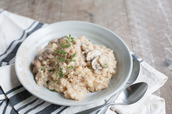 Easy Oven Risotto with Mushrooms | BourbonandHoney.com -- Creamy, cheesy and oh-so comforting, this Easy Oven Risotto with mushrooms is so quick to make that you can even serve it during the week!