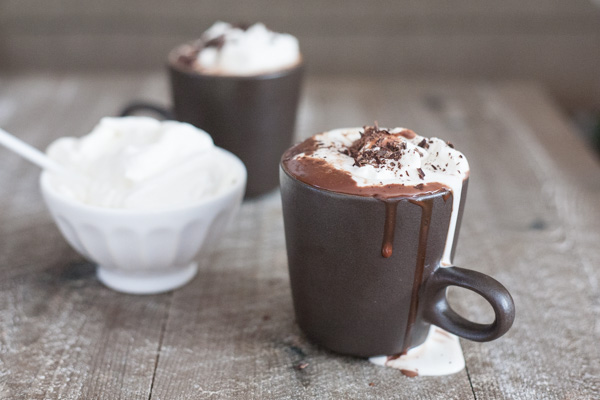 Bourbon Nutella Hot Chocolate with Bourbon and Honey Whipped Cream | BourbonandHoney.com -- Rich, chocolatey, spiked and delicious this Bourbon Nutella Hot Chocolate is topped with a Bourbon and Honey Whipped Cream and perfect for a cold night!