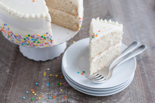 Champagne Cake with Buttercream Frosting | BourbonandHoney.com -- This Champagne Cake with Buttercream Frosting is the perfect cake recipe to celebrate with! It's light, tender, sweet and spiked with champagne!