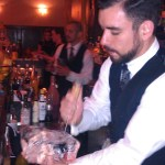 Tom McGuire carves ice into cubes by hand at Prohibition in Atlanta, Georgia
