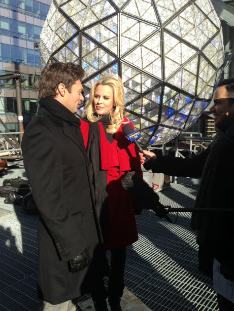 Host Ryan Seacrest and Jenny McCarthy talk in front of the Times Square Ball made of Waterford Crystals
