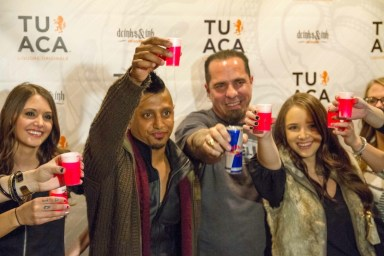 DJ Ravindrums and Corey Miller toast with TUACA at Drinks & Ink in Denver,Colorado