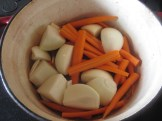 Carrots and onions in a pot