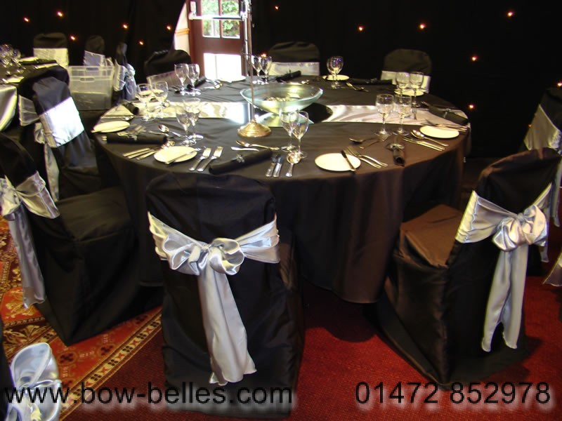 black chair covers to hire lazy boy recliner and a half wedding cover silver silk sash