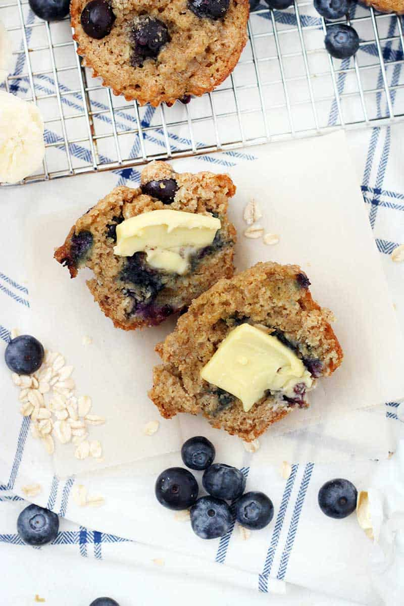 These Banana Blueberry Oat Muffins with 100% whole grains, no processed sugar, and coconut oil instead of butter! These muffins are hearty, healthy, and delicious, and freezable for a quick and easy breakfast any day of the week.