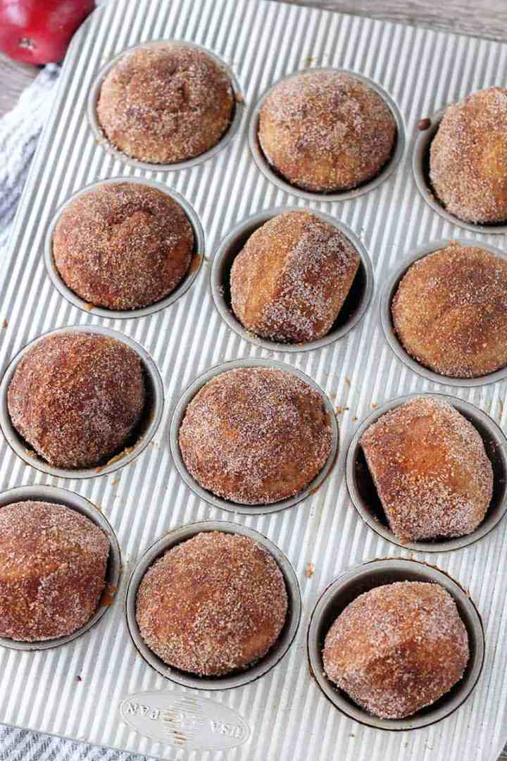 Whole Wheat Apple Cider Donut Muffins are melt-in-your-mouth, fluffy, and cake-like. They're partially sweetened with reduced apple cider, and brushed with melted butter and rolled in cinnamon and sugar after baking.