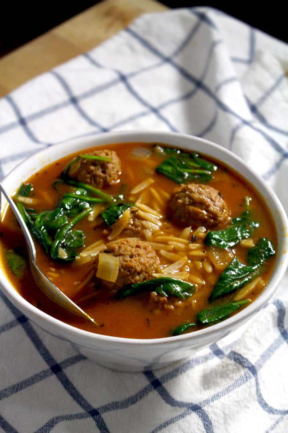 This Italian Spinach Orzo and Meatball Soup is comforting, healthy, and light. The balance between meat, whole grains, and vegetables makes for a well-rounded, soul satisfying meal. Try using leftover Turkey or chicken in place of the meatballs!