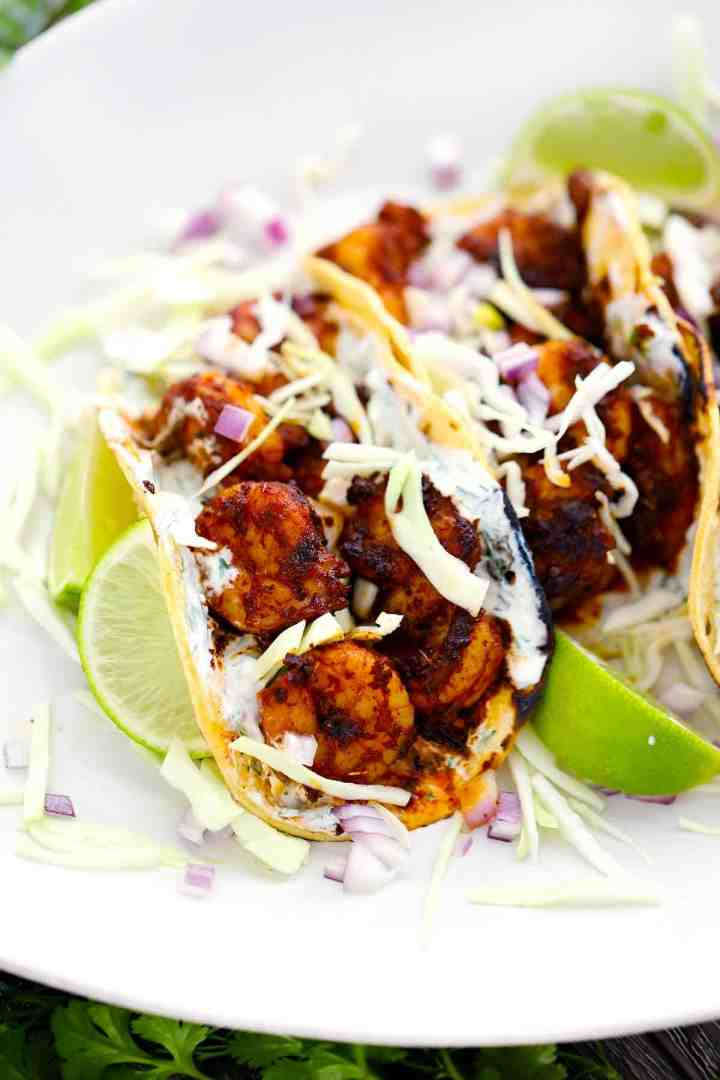 Healthy, fast, easy, light, and SO yummy. These blackened shrimp tacos will have you thinking you are on a sunny, warm beach in no time!