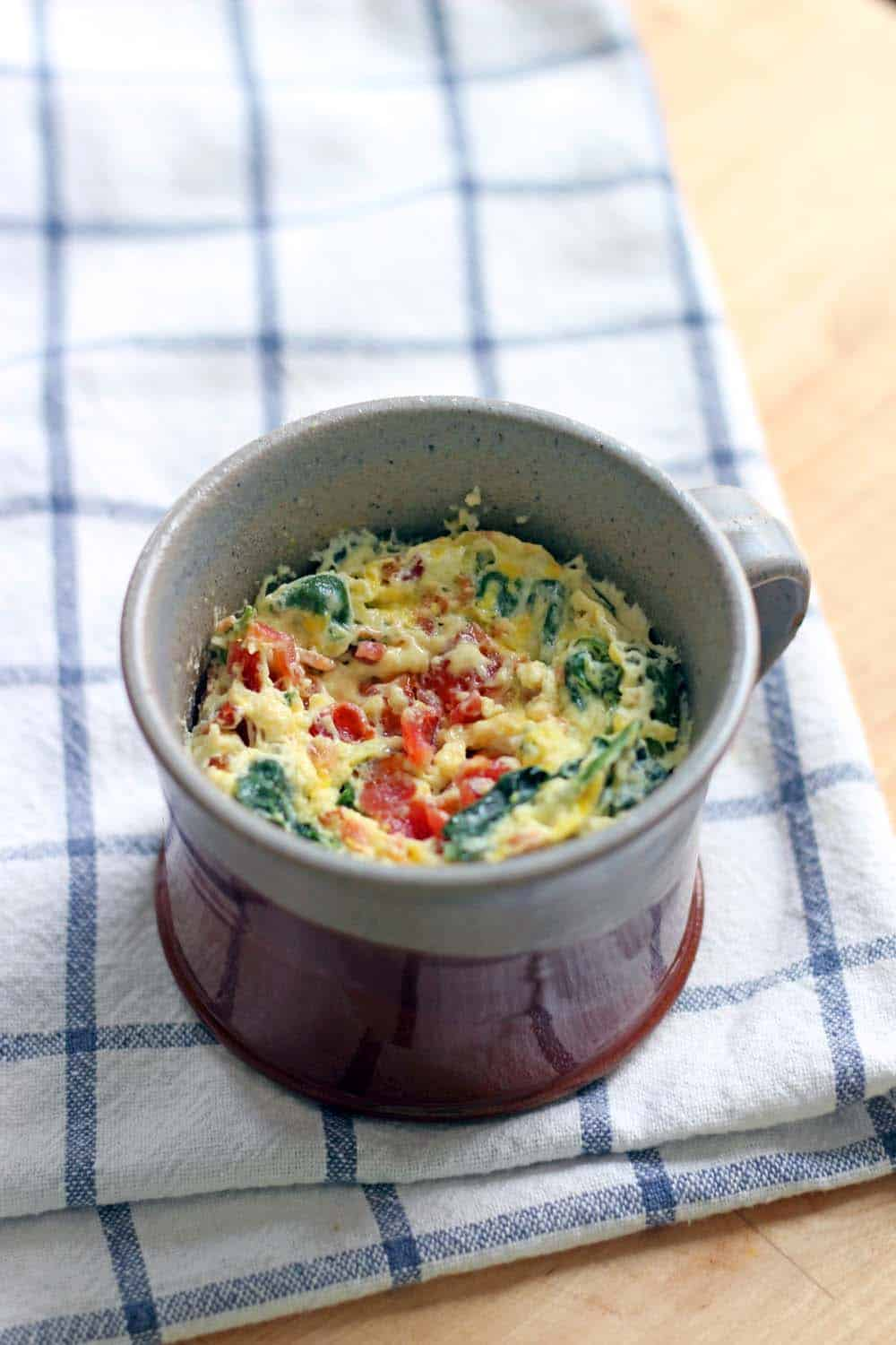 This Spinach and Cheddar Quiche takes only five minutes to make, and is a high protein, veggie-packed breakfast to kickstart your day! No more excuses for not eating breakfast.