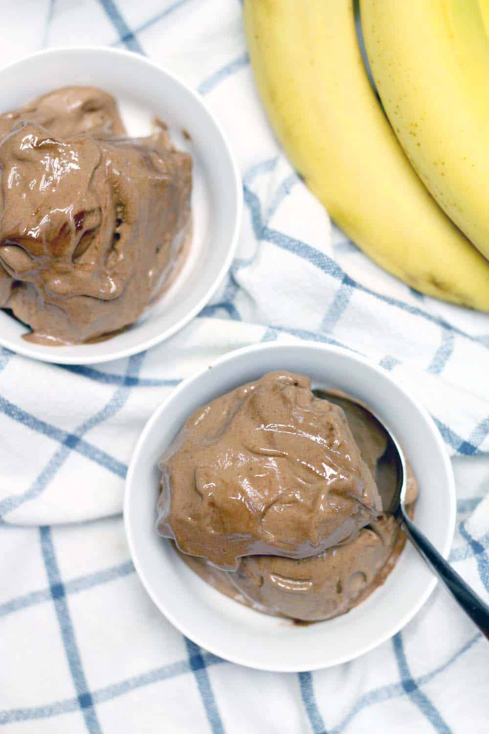This vegan chocolate banana ice cream is made of only TWO ingredients and is an awesome, healthy substitute for traditional ice cream!