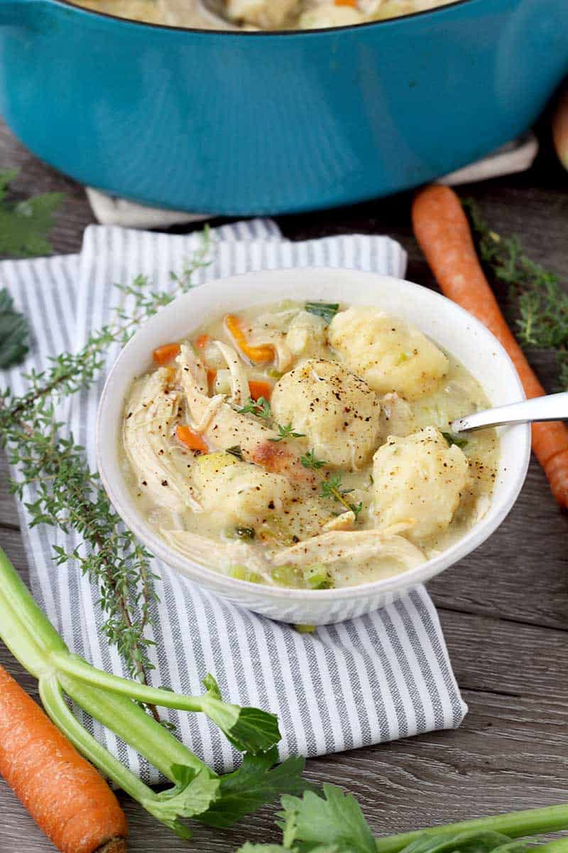 Easy Chicken and Dumplings from Scratch - If you use already cooked chicken (such as rotisserie) and store-bought broth, chicken and dumplings from scratch is a fast and easy comfort food meal to make on busy nights! The fresh thyme in the dumplings sets it over the edge.
