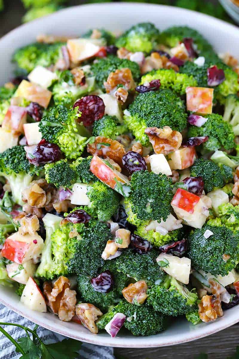 This broccoli salad with apples, walnuts, and cranberries is sweet, crunchy, and tangy. It's the perfect make-ahead side recipe since it doesn't get soggy and it makes a ton! Paleo, dairy free, gluten free, and vegetarian.