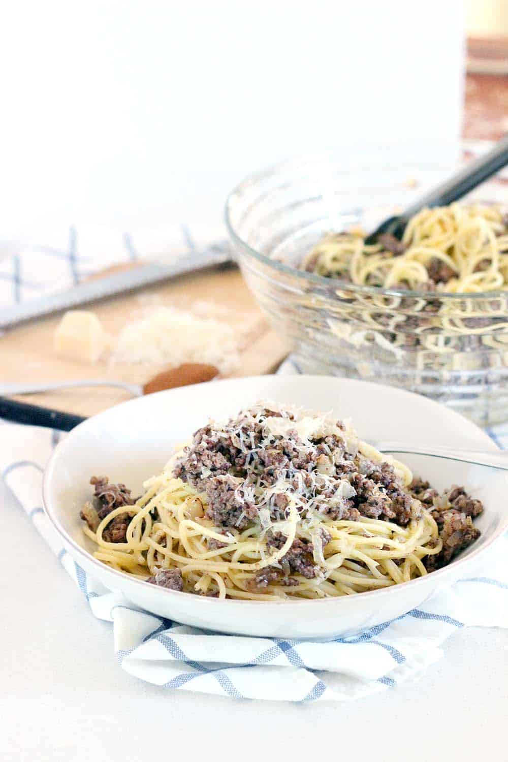 This recipe for Greek Spaghetti has browned beef spiced with cinnamon, is drizzled with earthy browned butter, and is sprinkled with Romano cheese. It's the ULTIMATE Greek comfort food! | www.bowlofdelicious.com