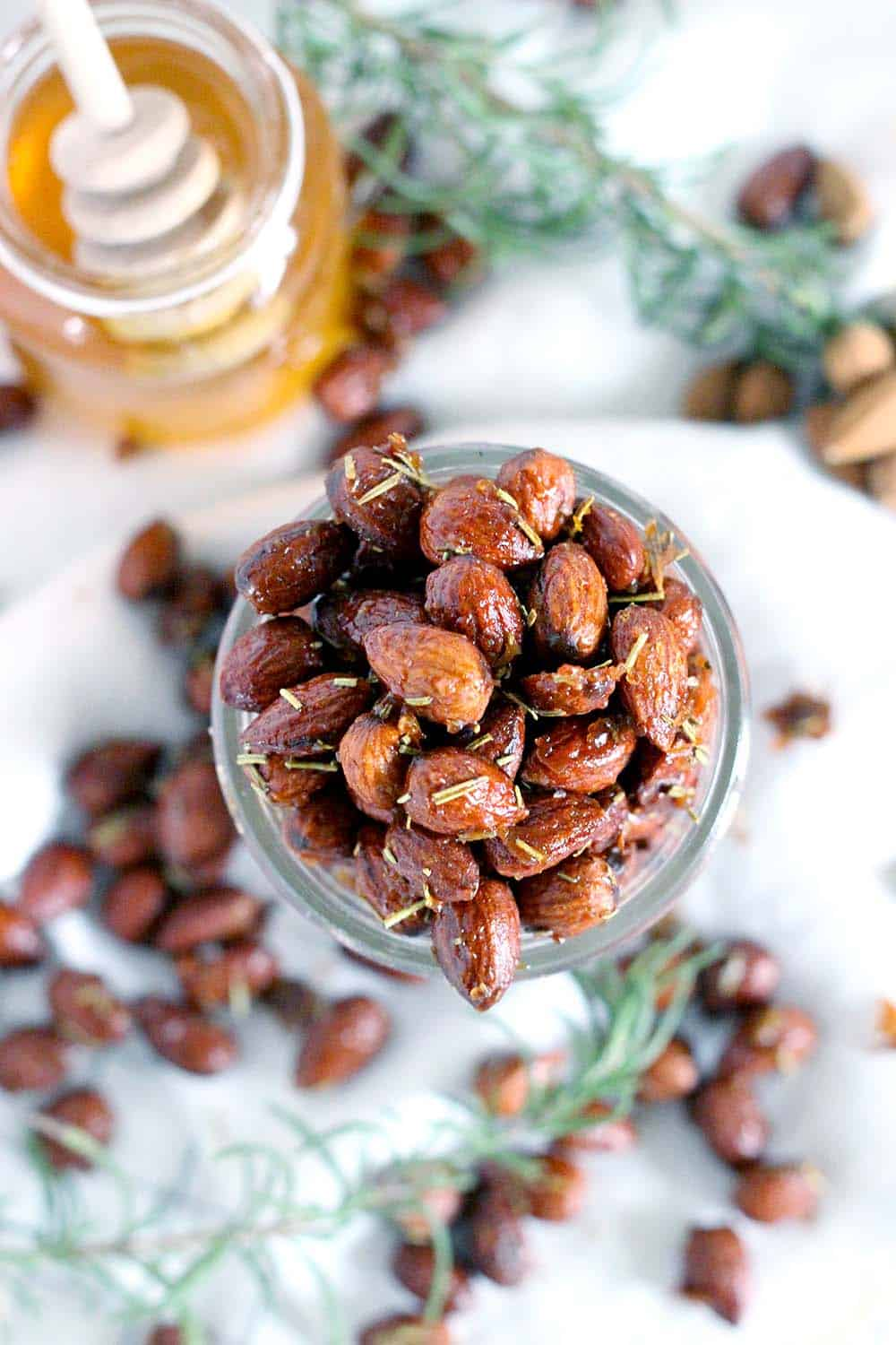 These Rosemary and Honey Roasted Almonds are my new favorite snack recipe- savory, sweet, and nutritious for a guilt-free midday treat! Plus, they're a cinch to make.