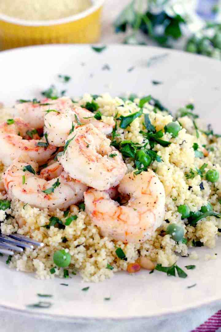 This Shrimp and Couscous with Peas and Mint recipe is a simple, healthy, 20 minute meal that's a cinch to make and perfect for spring!