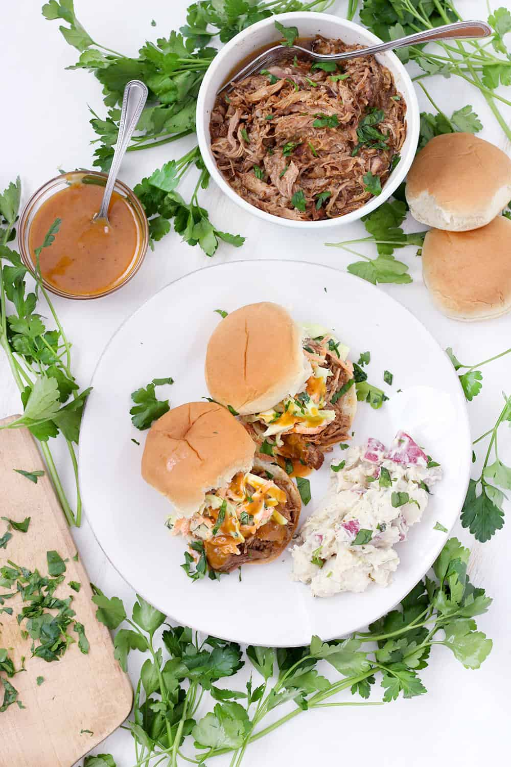 This Instant Pot Pulled Pork is a quick and easy recipe to feed a crowd! I love it served on slider buns with coleslaw or on tortillas with cilantro and onion. It's inexpensive, and the leftovers freeze beautifully.