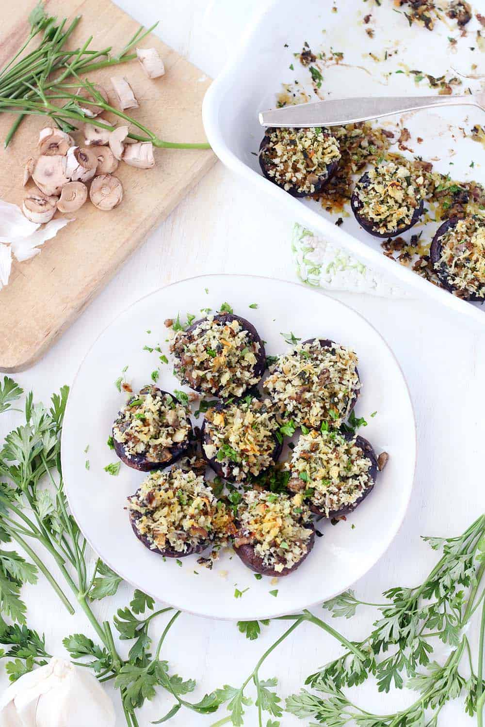 These Italian Vegetarian Stuffed Mushrooms are a great make-ahead recipe for dinner or an appetizer! They're packed with flavor from the fresh herbs, shallots, garlic, and parmesan cheese.