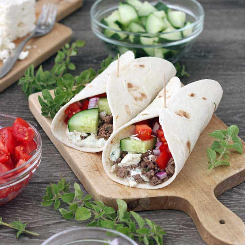 These Greek Lamb Tacos come together in only 30 minutes and are packed full of Mediterranean flavor! Topped with homemade tzatziki sauce and fresh cucumbers, tomatoes, onions, and feta cheese.