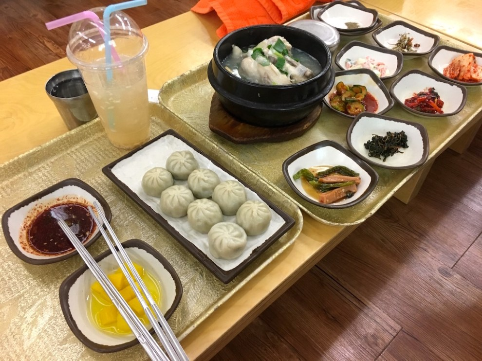 Samgyetang (Ginseng chicken), Mandu (raviolis) served with Kimchi and other Banchan (side dishes)