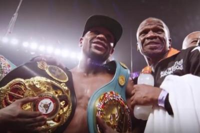 Mayweather vs Pacquiao - Floyd Mayweather victorious with belts