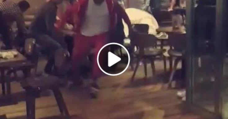 Chaos In Nandos As Billy Joe Saunders Attacks Deontay Wilder With A Piece of Chicken