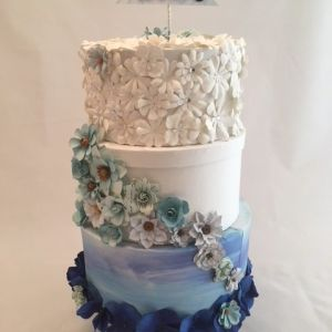 Looks like cake, but it is a card box. Blue themed Wedding card box, Marble blue paper and white material, with white flower accents.