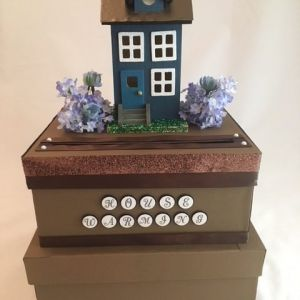 2 tier with house on top, Brown paper and sparkly ribbon, house is painted with copper roof and accented with flowers