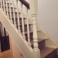 White stairs with walnut handrail  Boyle Joinery