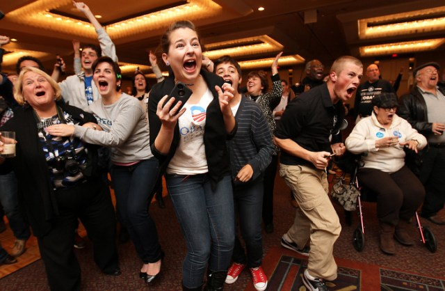 Supporters for President Barack Obama react to the news of his re-election at a victory party in Manchester, N.H., Tuesday, Nov. 6, 2012.