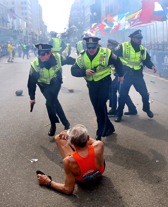 Boston-4/15/13- Boston Police officers Rachel McGuire, Kevin McGill and Javier Pagan react to a second  terrorist bomb exploding at the Boston Marathon. They ran after the first bomb exploded next to them near the finish line of the Boston Marathon that knocked down runner Bill Effrig on to Boylston Street.