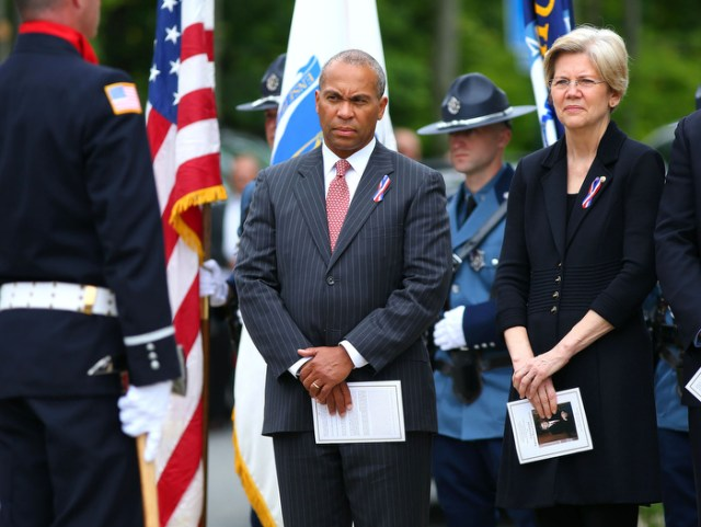 Hudson-06/14/13-  A funeral mass was held at Saint Michael Church for former Gov. Paul Cellucci , where friends, family and politicians attended. Gov. Deval Patrick stands with US Senator Elizabeth Warren as the service lets out.