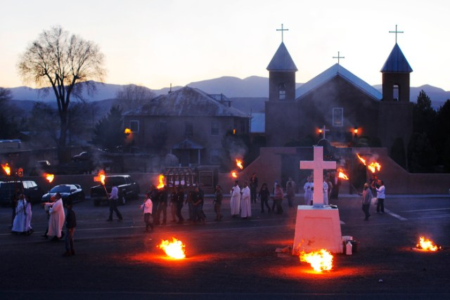 The clergy and the congregation walk in a evening Adoration of the Cross outside the Holy Cross Catholic Church on Good Friday in Santa Cruz, New Mexico March 29, 2013.