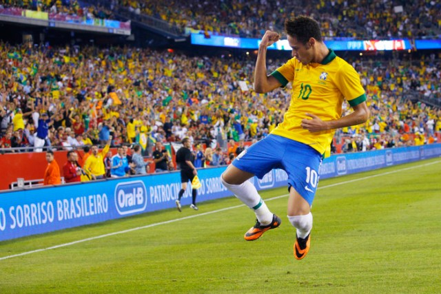 Brazil's Neymar celebrates after scoring against Portugal in the first half of their international friendly soccer match in Foxborough, Massachusetts September 10, 2013.