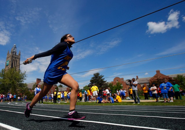 Angela Villota, from the New York Institute for Special Education, competes at the 67th annual Eastern Athletic Association for the Blind track and field tournament hosted at the Perkins School for the Blind in Watertown, Massachusetts May 18, 2013.  Blind runners hold on to handles on wires to guide them down the track and help them stay in their lane.