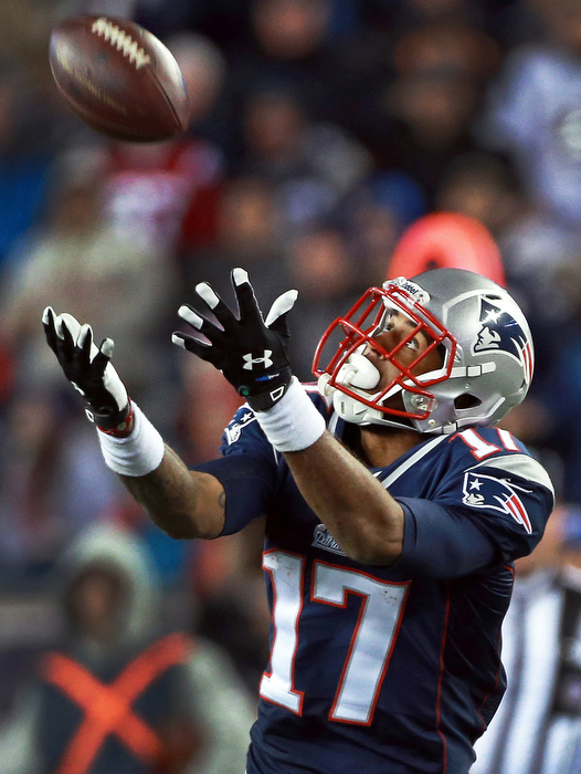 Patriots WR Aaron Dobson is wide open as he hauls in an 81 yard fourth quarter touchdown pass from Tom Brady that put New England ahead 48-31 on their way to a 55-31 victory over the Steelers