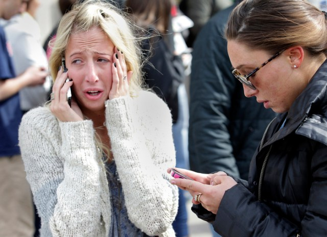 Boston, MA - 4/15/13-Women desperate to hear from loved ones after the explosions at the Boston Marathon can't enter the scene at Boylston and Mass Ave.