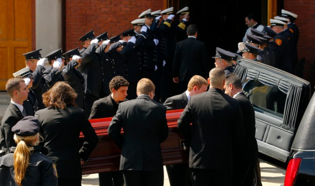 The casket containing the body of Krystle Campbel arrivesl at St. Joseph's Church for her funeral Mass in Medford, Massachusetts April 22, 2013.  Krystle Campbell died in the two explosions that hit the Boston Marathon April 15 killing at least three people and injuring over 100 others.