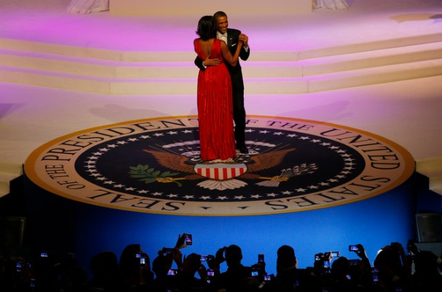 U.S. first lady Michelle Obama, wearing a Jason Wu dress, dances with U.S. President Barack Obama at the Commander in Chief's ball in Washington, January 21, 2013.