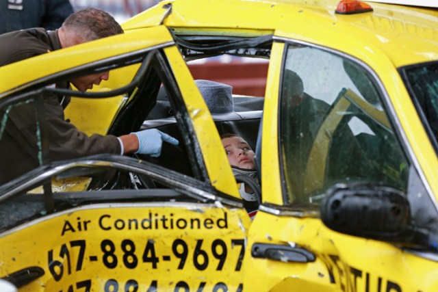 (Boston, MA  12/10/2014) A 7 year-old boy who was traveling with his grandfather in a taxi waits to be extricated from the vehicle as four people were injured in a crash between the taxi and pickup truck on Meridian Street Bridge on Wednesday, December 10, 2014. Slick driving conditions caused the taxi to spin out according to police.