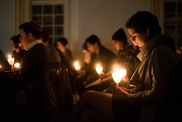 Members of the Tufts community join together in a candlelit moment of silent reflection following the triple homicide of Yusor Mohammad Abu-Salha, her husband Deah Barakat, and her sister Razan Mohammad Abu-Salha.