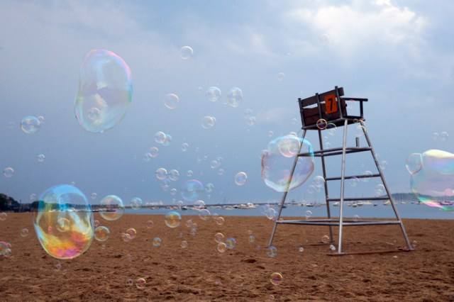 Bubbles from  Giant Beach Bubbles fill M Street Beach as part of Summer on the Waterfront in South Boston, Massachusetts August 18, 2015.