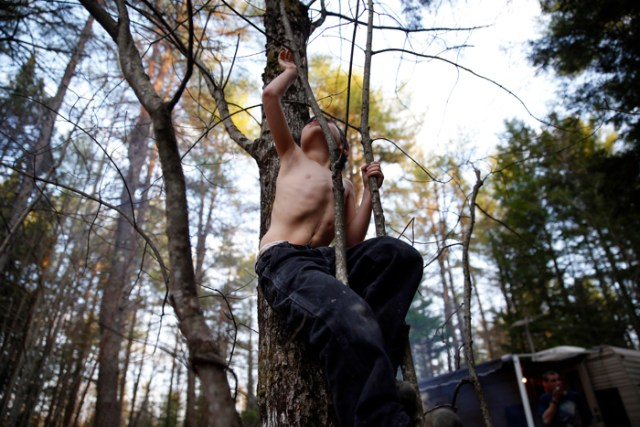 Strider reached up to grab high on a sapling revealing a scar that snaked its way up his stomach and a dimple that marked the place where a feeding tube had once been as he climbed a tree in the first of several campgrounds that would come to be home throughout the course of the summer.