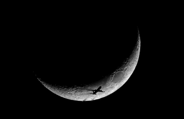 01/23/15-Boston,MA A high altitude jet exits the U.S. East Coast, in front of a crescent moon. Flight tracking software found this to be an Austrian Air Boeing 767, flying from JFK, New York to Austria.