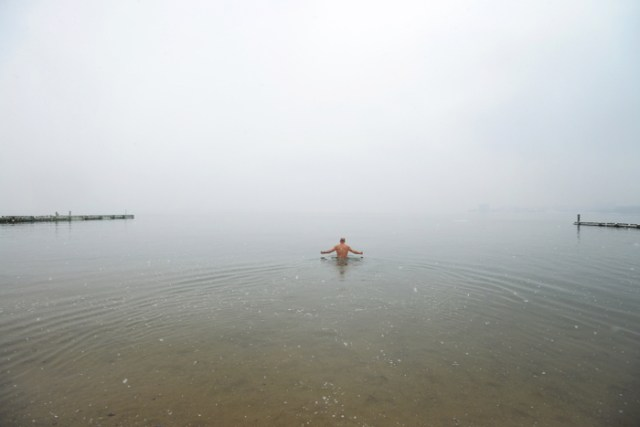 (Boston, MA 03/21 /15) Chris DeSisto takes a lone dip in the water after everyone has run out during the  2015 Harpoon Helps Cupid Splash on at the BCYF Curley Community Center in South Boston. Support your local beaches. March 21,  2015