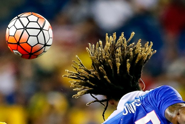 United States midfielder Jermaine Jones heads the ball away during their game against Brazil at Gillette Stadium.