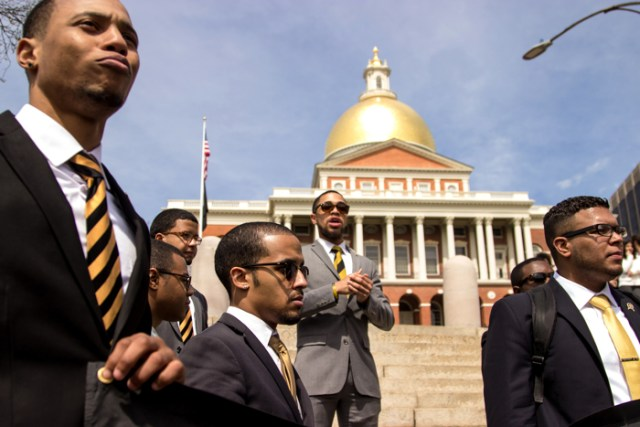 April 9, 2016 - Brothers of the Sigma chapter of Alphi Phi Alpha (from left) William Belt, Yassine El Yousfi, Jamil Williams, and Ricky Rodriguez stand in front of the Massachusetts State House after leading a march from Marsh Plaza in Boston, Mass. to speak out against Donald Trump.