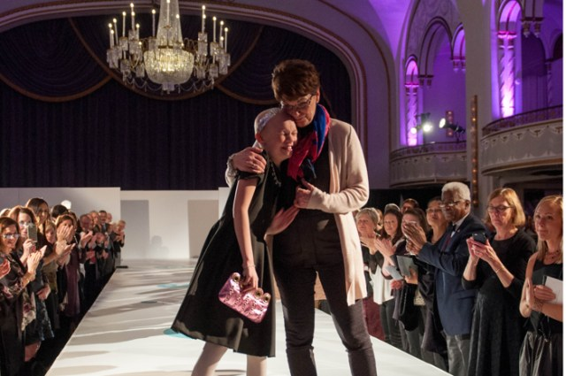 Boston, November 19, 2015- Nicole Schindler, 10, walks with her oncologist Rachel Bolton in Couture for Cancer Care, a benefit and a fashion show that was organized by the Friends of Massachusetts General Cancer Center. After 9 months of treatment, Nicole, a softball player and jazz dancer, was able to beat brain cancer.