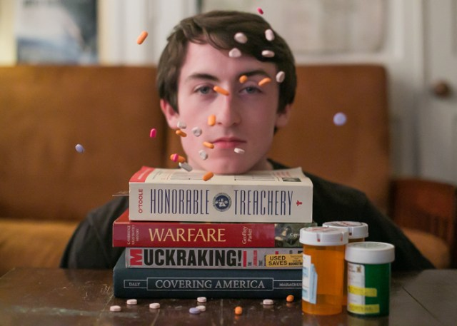 October 18, 2015 - Boston, Massachusetts: Adderall and other assorted academic-stimulant pills fall in front of Lucas Esposito's face. In 2012, over 116,000 people were admitted to rehab for an addiction to amphetamines like Adderall.