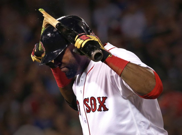 Boston Red Sox designated hitter David Ortiz snaps his bat over his head in anger after grounding out stranding base runners at second and third during the sixth inning of a game against the Kansas City Royals at Fenway Park in Boston.